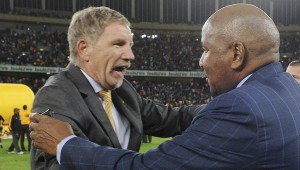 Stuart Baxter, coach of Kaizer Chiefs with Chairman of Kaizer Chiefs, Kaizer Motaung during the 2014 MTN 8 Final match between Orlando Pirates and Kaizer Chiefs