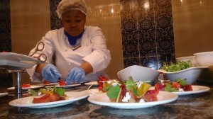 One Of The Assitant Chefs Plating Up At The Preview Eevning